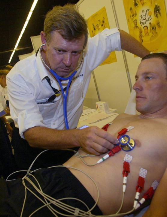 Tour de France's doctor Gerard Porte controls the heartbeat of Lance Armstrong in 2003.