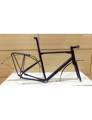 An aluminium 03 frame with the optional fenders and rear rack fitted