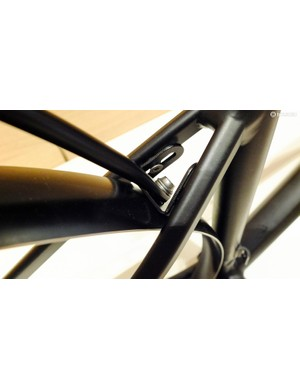 Tidy bracket supporting the fender and rack between the seat stays