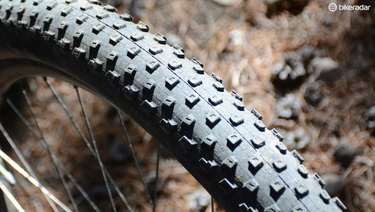 The Frank Stacy-designed tire features small, symmetrical knobs to skim the trails