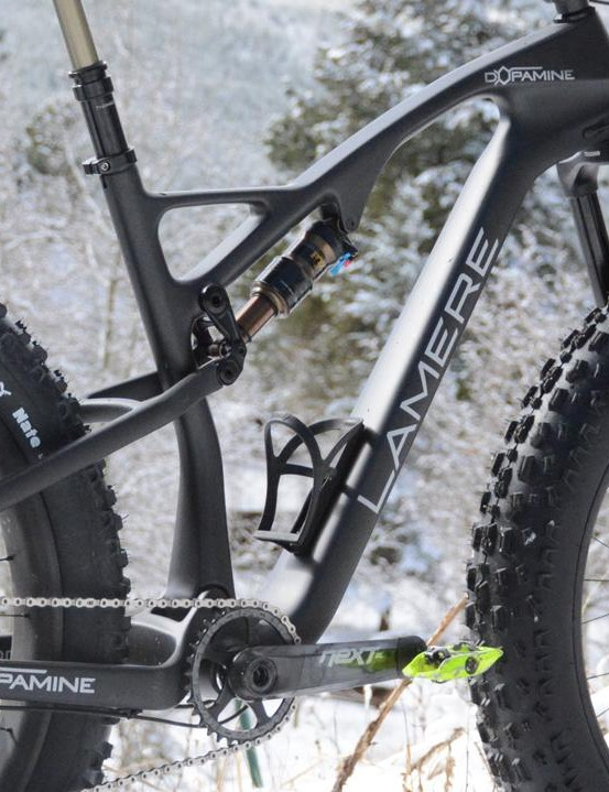 The carbon frame features a healthy 115mm of rear travel