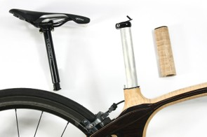 An aluminum seatmast is bonded to the frame and a wood aero fairing slips over top. Saddle height adjustments can be made with the 27.2mm seatpost