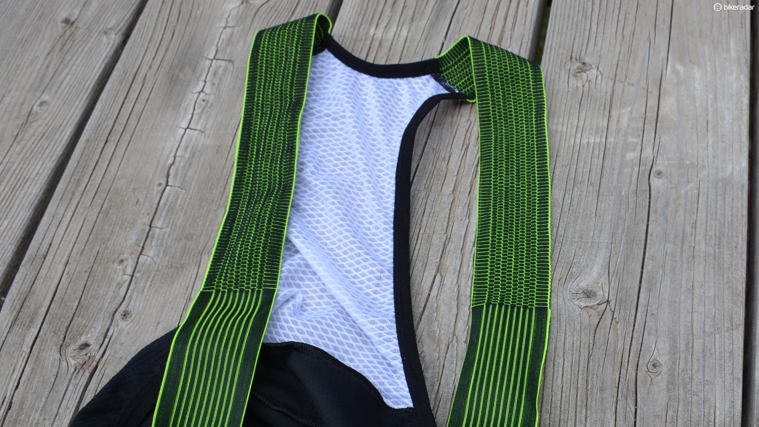 The bib straps switch from a purely vertical stretch to a more dynamic stretch halfway up