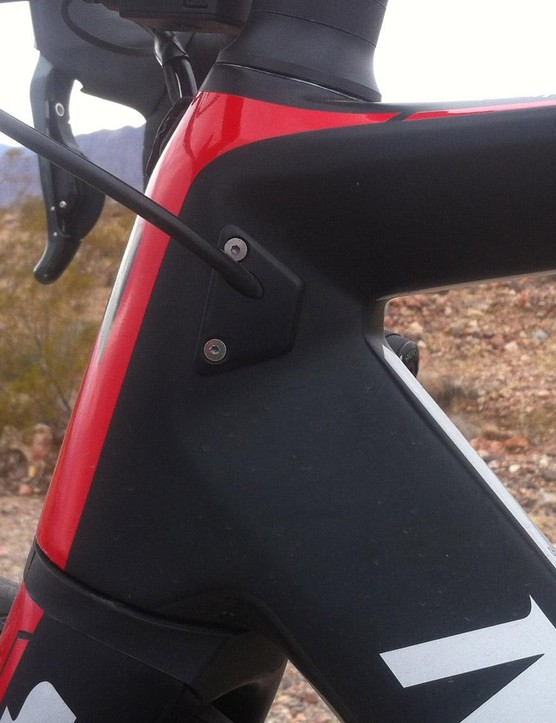 The rear hydraulic brake hose enters the frame on the side