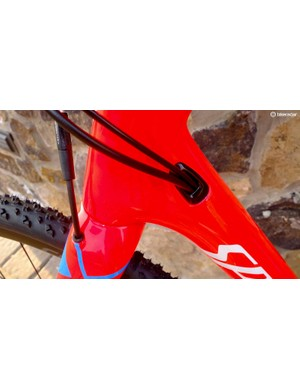 One port neatly handles the rear mech cable and brake hose
