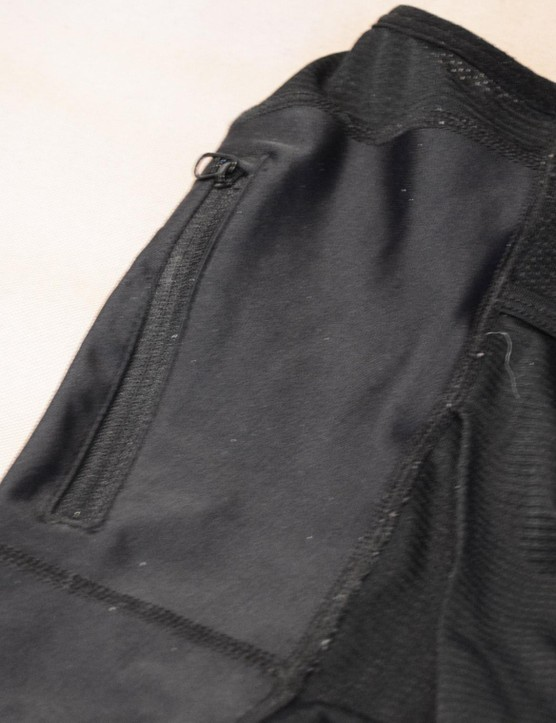 The small, zipped pocket is thin — perfect for cash