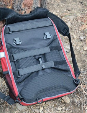 The backpack straps and the Velcro rack straps can be tucked under the rear panel