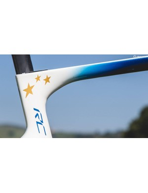 A deep metallic blue fades to white on the frameset with the stars of Europe adorning the seat cluster