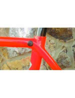 The seatpost clamp is now internal, with the bolt accessed from behind this rubber bung
