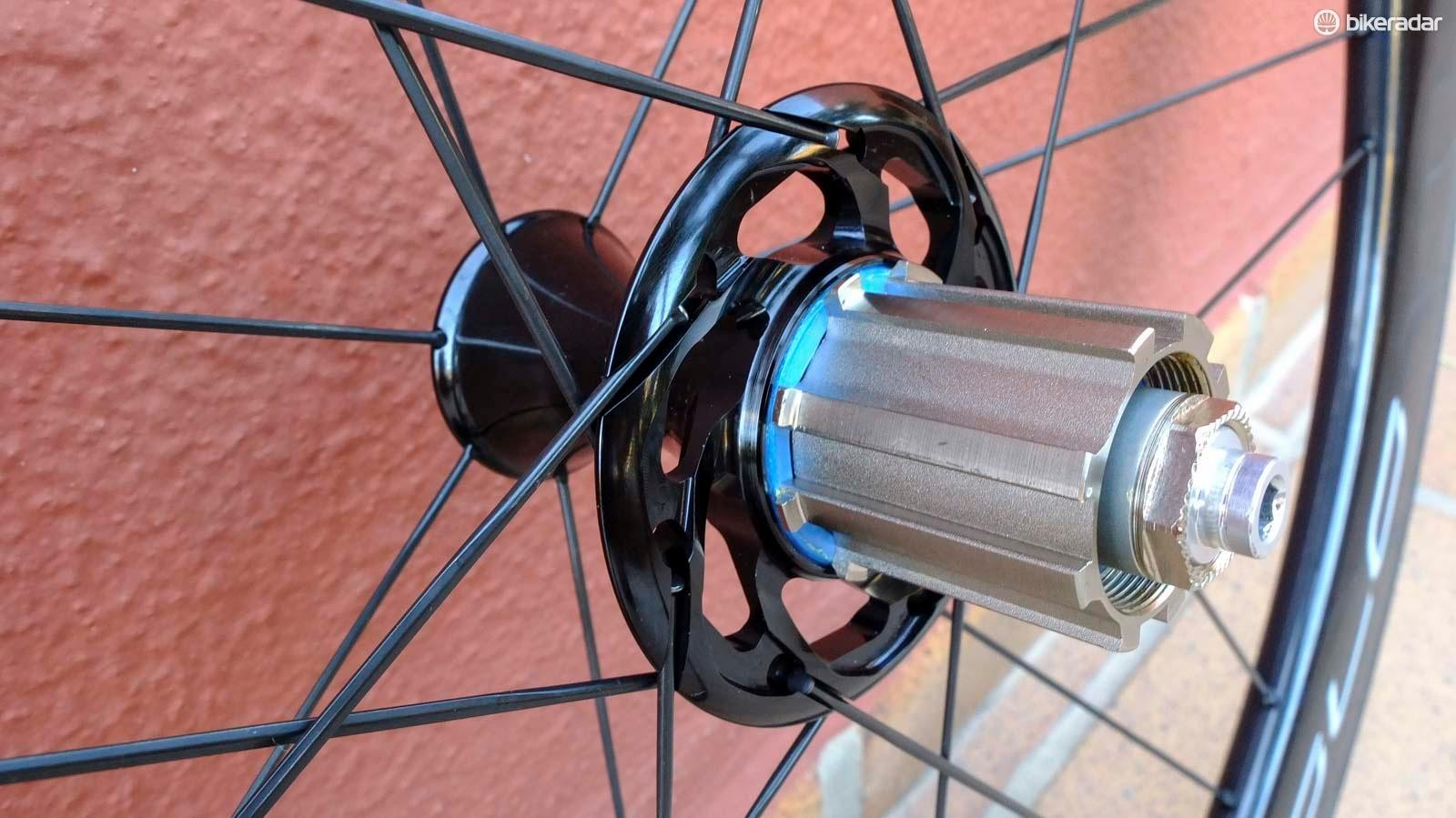 The rear hub uses an enlarged driveside flange and both have new diamond-profile straight-pull spokes