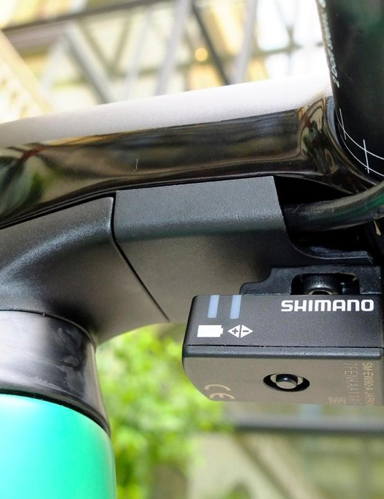Both brake hoses are routed through a covered channel beneath the stem, and the Di2 control box clips on