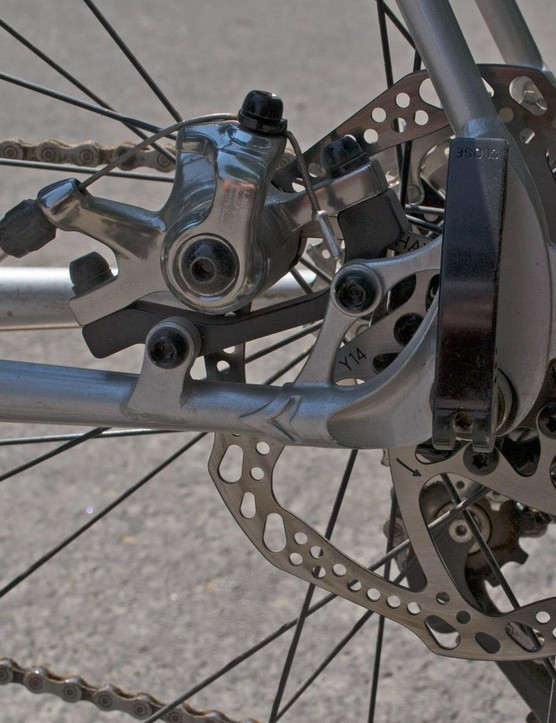 The rear disc tucks neatly between the stays and leaves room for rack mounts