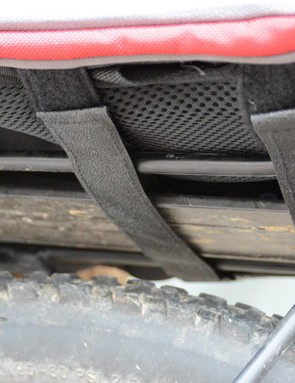Three Velcro straps allow attachment to a rack as a trunk bag