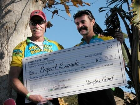 50-Mile Ride organizer Doug Grant (l) presents Tom Ritchey with a big fat check in 2006.