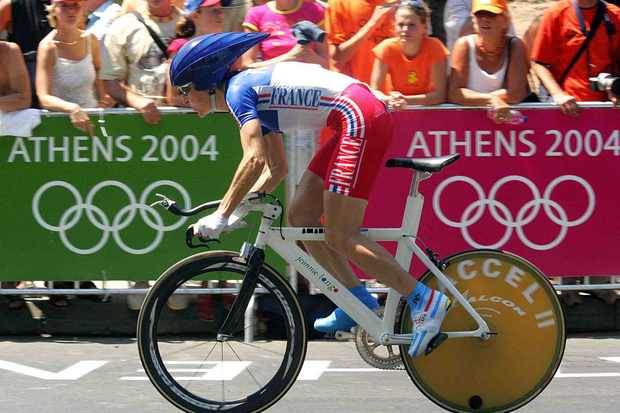French cyclist Jeannie Longo racing in Athens, her sixth Olympics.