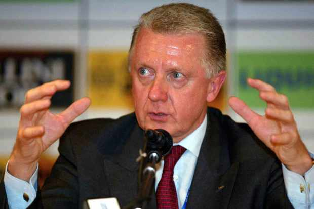 Former UCI chief Hein Verbruggen gestures as to the amount of cash paid to get the keirin into the Olympics.