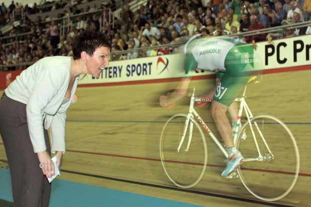 Britain's Chris Boardman sets the new hour record on a stock steel bike in 2000 as his wife Sally cheers him on.