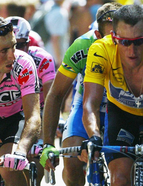 Joseba Beloki (L) and Lance Armstrong battle it out on Mont Ventoux in July 2002.