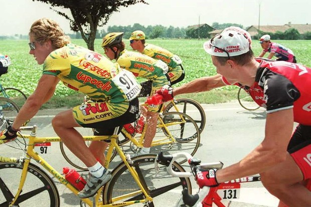 Russian hijinks in the Tour peloton:  Andre Tchmil (R) sprays compatriot Sergei Outschakov in 1995.
