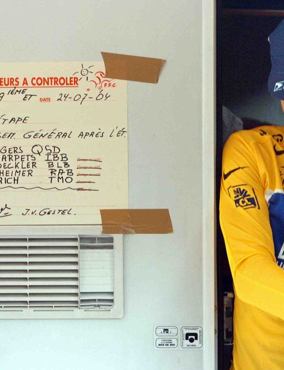 Lance Armstrong leaves the doping control trailer during the 2004 Tour de France.