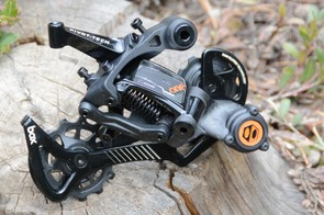 Box's rear derailleur uses a clutch, an aluminum cage and sealed pulley wheel bearings