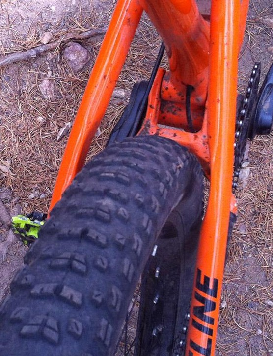 There's a mile of room in the rear triangle. Rocky Mountain claims a 3.25in tire will fit