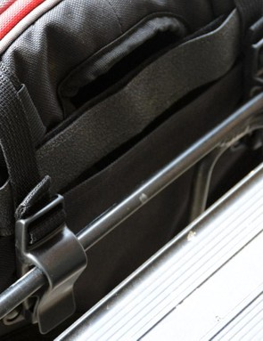 Two clips on the top and a hook on the bottom secure the Outlier when used as a pannier