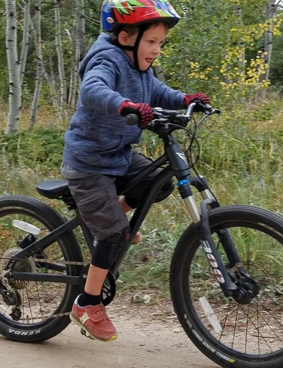 Just like adults, kids are stoked with a new bike