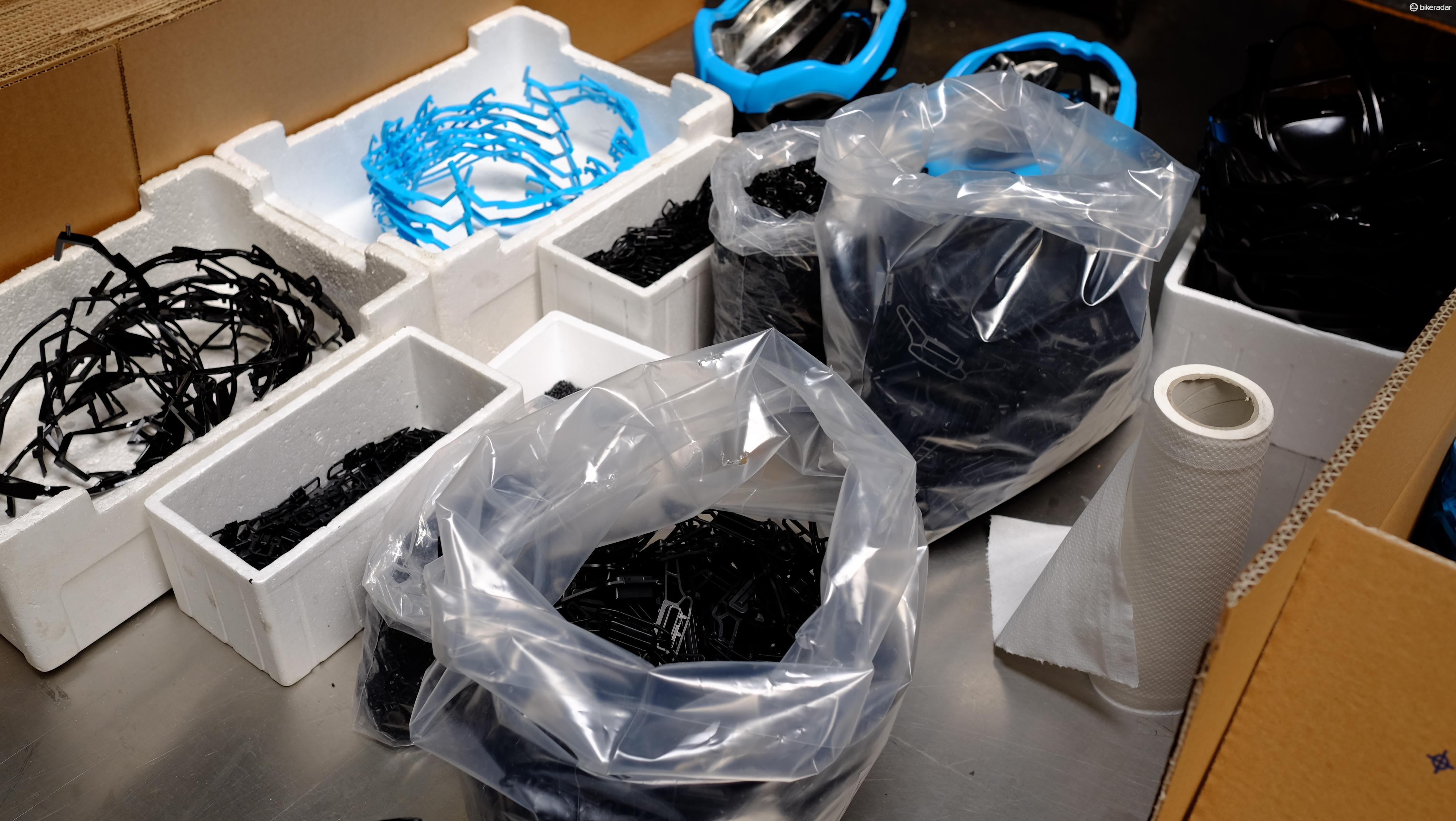 The components we saw earlier are then loaded into a machine alongside these additional plastic parts