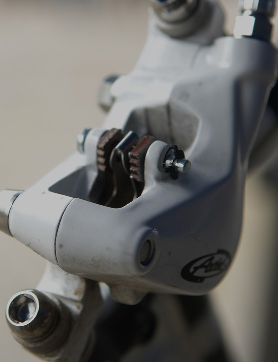The all-new caliper uses a different pad retention system.