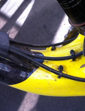 Internal cable routing exits just forward of the rear shock