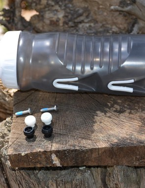 The kit comes with black and white studs, four bolts, and the bottle
