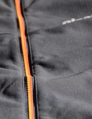 The dual colored zipper is a nice touch and features a wind barrier behind it