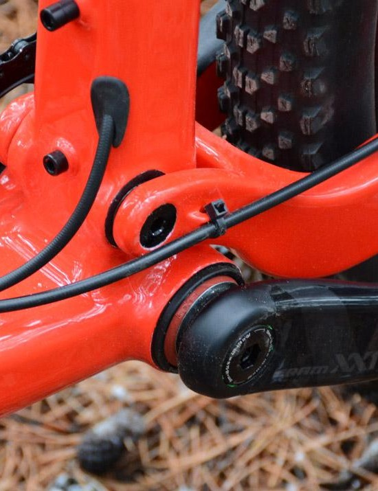 The dropper post enters on the front side of the seat tube