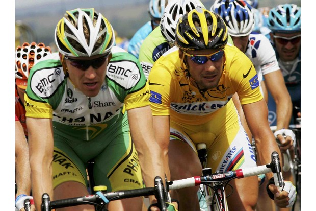 Belgian Tom Boonen (R) enjoys yellow next to Axel Merckx in 2006.