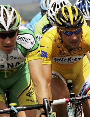 Belgian Tom Boonen (R) enjoys yellow next to Axel Merckx in 2006.