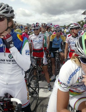 Nicole Cooke (L) next to world champ Regina Schleicher at the front of the women's field before the