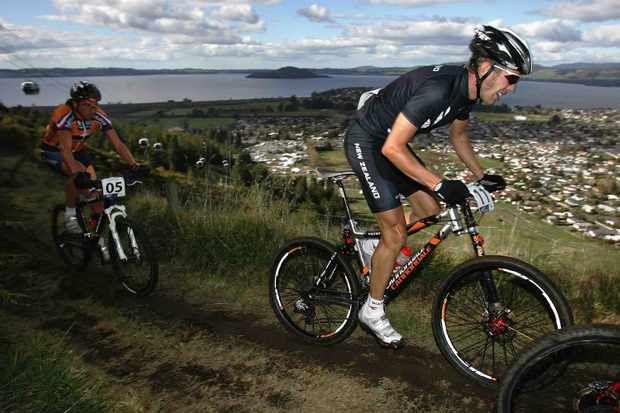 Cannondale racer Kashi Leuchs of New Zealand leads Bart Brentjens of the Netherlands in the Elite Mens Cross-Country competition on the slopes of Mount Ngongotaha on day six of the Mountain Bike World Championships August 27, 2006 in Rotorua, New Zealand.
