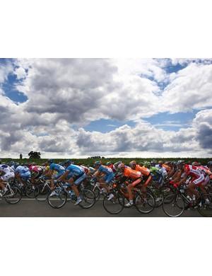 The peloton races through Flanders