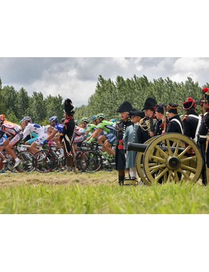 Spectators dressed-up as Napoleonic soldiers watch the second stage of the Tour