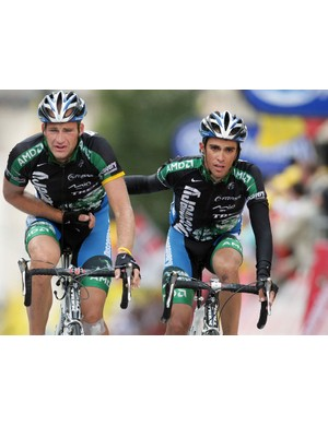 Tomas Vaitkus is escorted home by teammate Alberto Contador