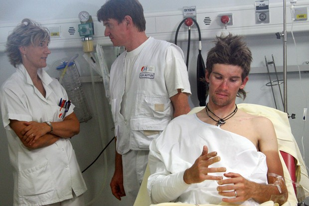 Andreas Kloeden (Astana) lies in a bed at the Hospital center in Autun as he has been taken care of
