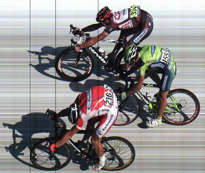 Not everyone can cross the line at once. To avoid everyone contesting the finish, each rider in a given bunch is awarded the same time.