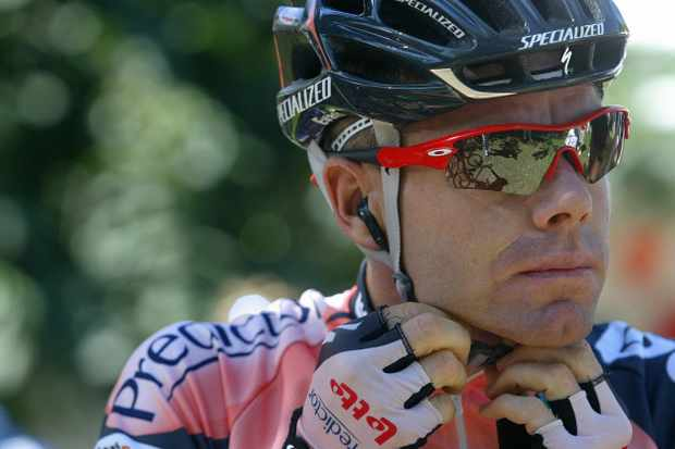 Cadel Evans buckles up in anticipation of handing over $50,000 to charity
