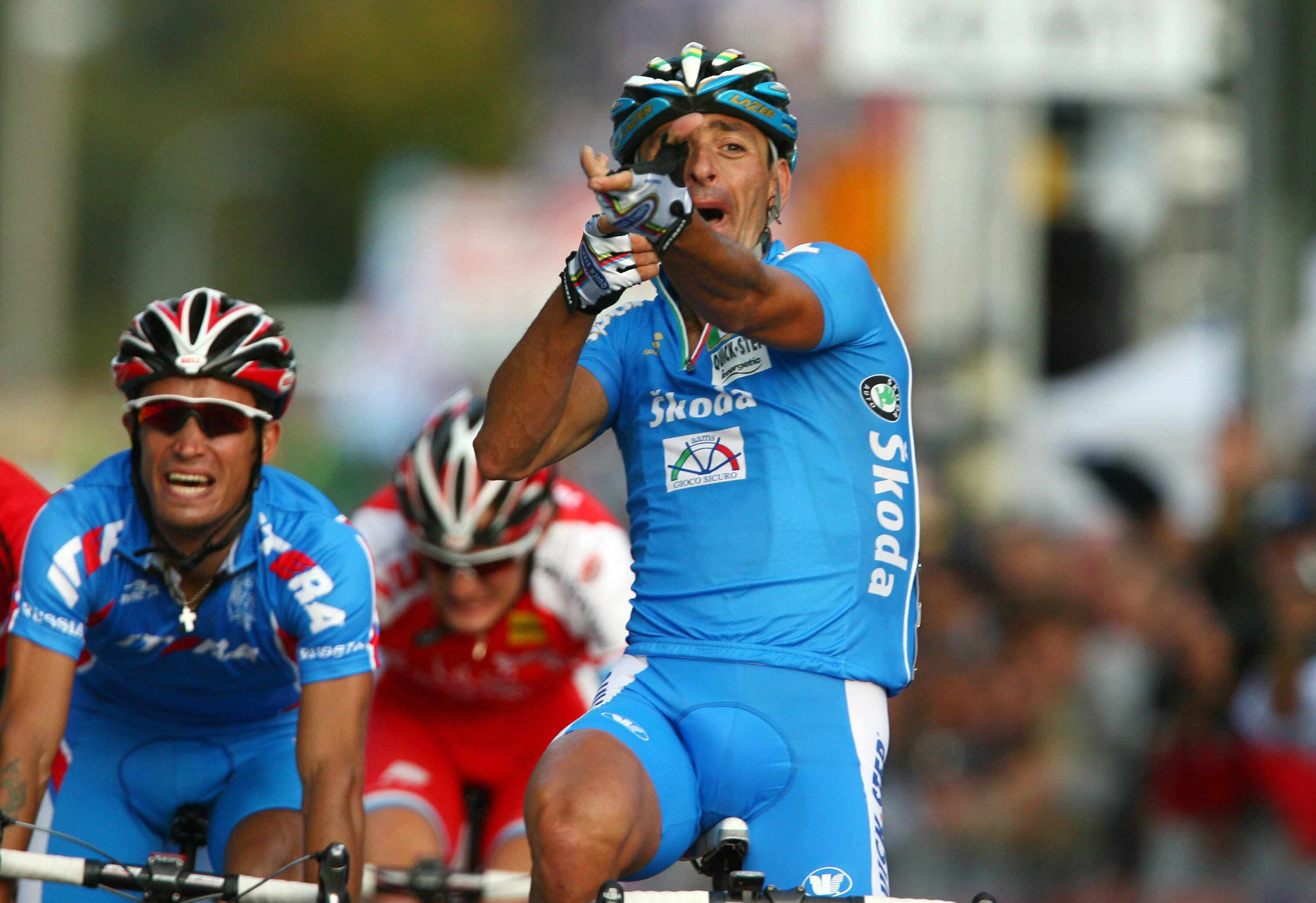 Bettini reminds the UCI who's in whose crosshairs after winning World's in Stuttgart.