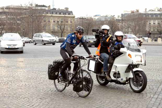 Scottish cyclist Mark Beaumont completes his 18,000-mile around-the-world journey in Paris Feb. 15 in 194 days.
