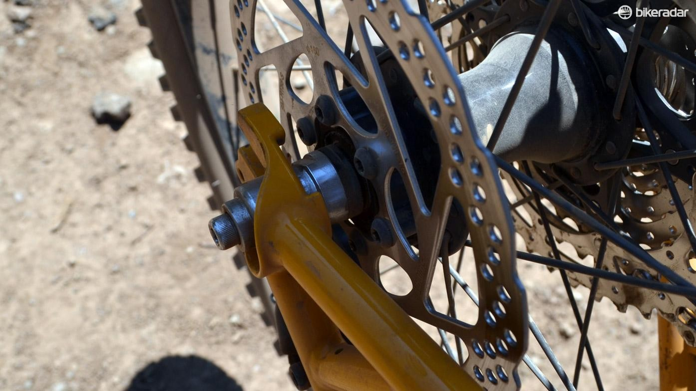 See the little notch that mimics a vertical dropout? No more messing with the rear brake caliper; rear wheel installation and removal is easier than ever