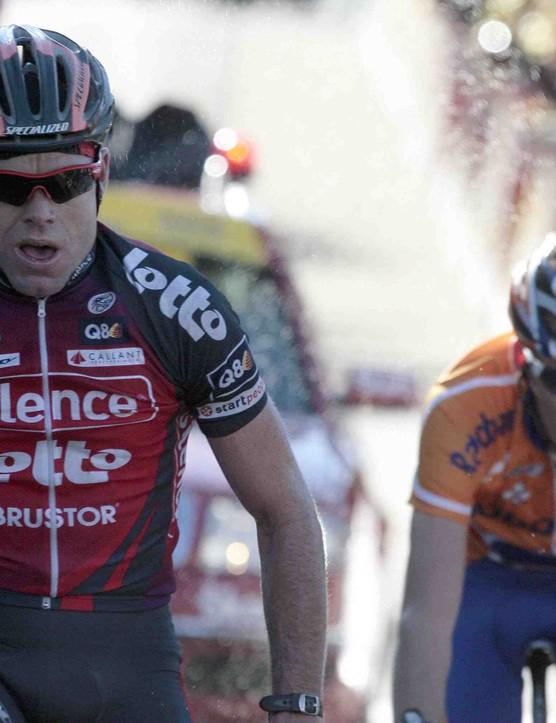 Cadel Evans (L) wins the Mount Ventoux stage of Paris-Nice.