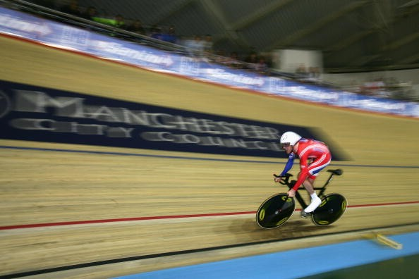 Great Britain's Bradley Wiggins en route to individual pursuit gold in Manchester Thursday.