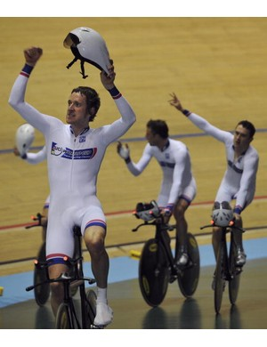 Britain's Bradley Wiggins celebrates his team's victor in Manchester Thursday.